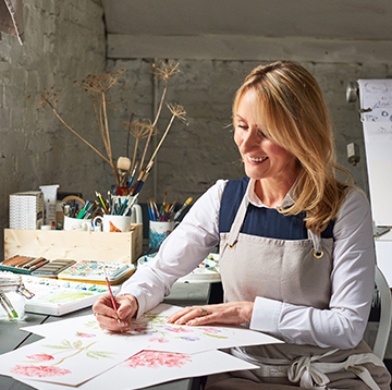 Jane Abbott hand painting designs for her ceramics